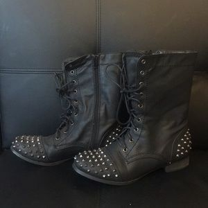 Combat style boot with spikes on toe and heel